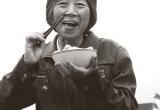 Farmer eating rice