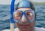 Israel Ziv snorkeling near Champion Island, Galapagos, Ecuador, South America.