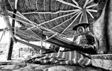 A peruvian woman weaving