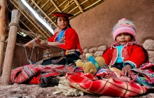 A weaving woman with baby