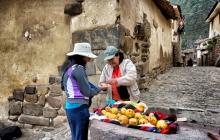 A street merchant sells fruits