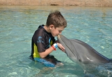 47 Asher kissing Dolphin AtlantisPhoto_34