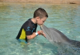 50 Jonah kissing the dolphin AtlantisPhoto_44
